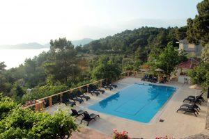 Pool and sea view at Faralia Hotel at Faralya village Fethiye Turkey