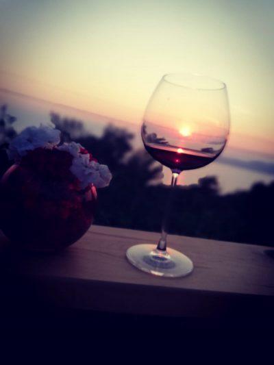 Faralia hotel enjoying a vine at sunset restaurant
