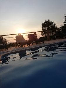 Faralia Hotel sunset view on poolside