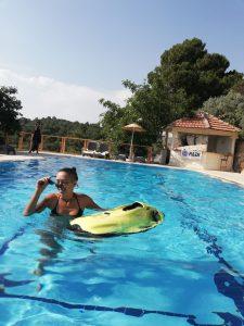 Faralia Hotel pool view with a seabob girl Faralya Village Fethiye