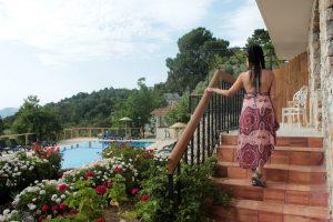 Faralia hotel pool view with a beautiful lady